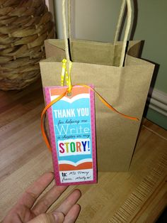 End of the year teacher gift - Homemade Bookmark and gift certificate to bookstore and blank journal.