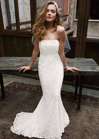 Allover beaded lace gown with empire waist. Sweep train. Available in stores in Ivory. Available for special order in stores in White. *SPECIAL VALUE! Was $499.00, Now $299.99! (final selling price; no additional discount may be applied). To preserve your wedding dreams, try our Wedding Gown Preservation Kit.A train that just brushes the floor.A bodice with a high waistline directly below the bust. A great look for most body types.