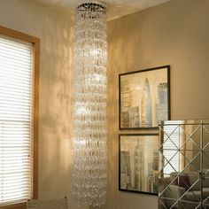 """C Chandelier.  17"""" dia x 99"""" Long.  Formed by interlocking crystal C's  $3500"""