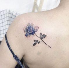 Blue ink rose tattoo on back shoulder by Tattooist Flower #flowertattoosonback