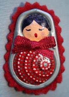 Matryoshka: Pop tabs from canned tuna, air dry clay, acrylic paints, permanent markers, felt.