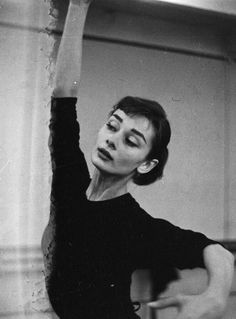 Audrey Hepburn photographed by David Seymour while at dance rehearsal for Funny Face, 1956