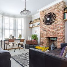 Exposed brick walls and brick wallpaper – everything you need to know <br> Consider stripping back your walls to the bare brickwork to reveal instant character – or cheat using brick wallpaper! The choice is yours. Exposed Brick Fireplaces, Brick Fireplace Wall, Exposed Brick Walls, Living Room With Fireplace, Living Room Brick Wall, Exposed Brick Wallpaper, Living Room Ideas With Brick Wallpaper, Living Room Decor With Yellow Walls, Living Room Ideas Exposed Brick