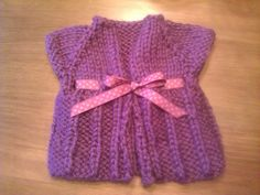 Love this sweater for baby girls.