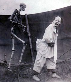 Vintage photo of a French clown and his friend