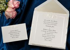 Affordable wedding invitations This bright white square card has a subtle scalloped edge. There are roses embossed in pearl at the top by Wedding Invitations -The Office Gal