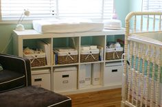 Ikea bookshelf turned on it's side...very smart and nice with all the cubbies for storage, baskets, etc. Cute room.