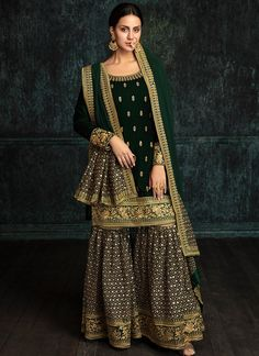 Emerald Green Velvet Embroidered Gharara Suit features a velvet kameez with santoon inner, georgette bottom with santoon inner alongside a georgette embroidered dupatta. Embroidery work is completed with zari and stone work embellishments. Pakistani Wedding Outfits, Pakistani Dresses, Indian Dresses, Indian Outfits, Green Velvet Dress, Velvet Suit, Gharara Designs, Bollywood Dress, Royal Clothing