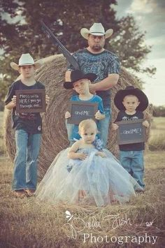Baby girl photo with protective brothers and father.