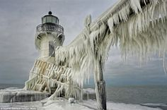Picturesque: This lighthouse was captured in the city of St Joseph. The structures can remain frozen for over a month during particularly se...