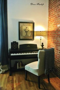 CHALLENGE:   *FIT PIANO INTO A TINY NYC LOFT  *MESH SEAMLESSLY WITH ROOM DECOR    SOLUTION:   *SWAP PIANO BENCH WITH A CLASSIC UPHOLSTERED CHAIR  *DRESSED TOP SURFACE WITH LIGHTING & ACCESSORIES