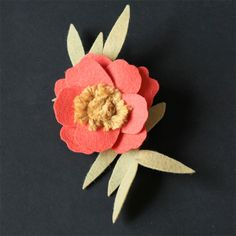 Make a beautiful anemone flower with just a little felt and yarn!