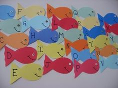 Easy Magnetic Fish to play Fishing for Letters (can use a staple instead of an eyelet)
