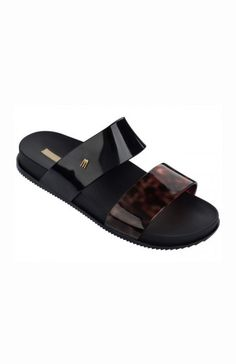 Product Details:A slip on slide featuring one black and one tortoiseshell strap. Material Details:Made from Melflex plastic