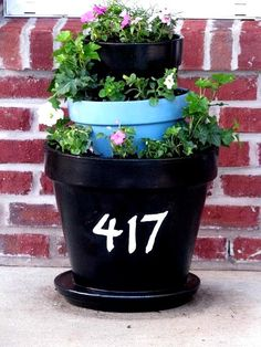 Address Pots- this is kinda cute if you had a small porch and needed something that pops. I'd go with a purple hanging flower on the bottom. Even next to a mail box?