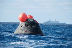NASA's Orion spacecraft awaits the U.S. Navy's USS Anchorage for a ride home. Orion launched into space on a two-orbit, 4.5-test flight at 7:05 am EST on Dec. 5, and safely splashed down in the Pacific Ocean, where a combined team from NASA, the Navy and Orion prime contractor Lockheed Martin retrieved it for return to shore on board the Anchorage. It is expected to be off loaded at Naval Base San Diego on Monday. Photo credit: U.S. Navy