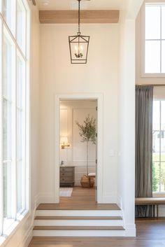 Wood beams, lantern pendant, lantern hallway, door casing #interiordesign