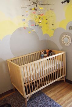 Wall paint, mobile, stuffed animal cluster: this room has all things wonderful.