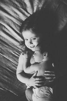 cute siblings with newborn photos