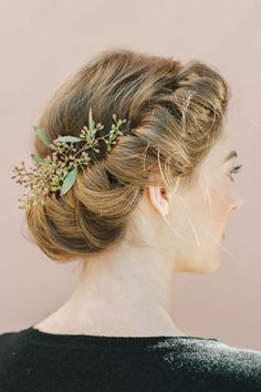 Festive Hairstyles To Dazzle 'Em All #refinery29 http://www.refinery29.com/holiday-hairstyles#slide1 The Romantic Roll Channel your inner flower child with this easy-to-do twisted wreath look.