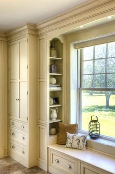 Victorian Gallery Page 1 | Crown Point Cabinetry - Window seat with side cabinetry/shelving. I couldn't think of a more beautiful place to sit and read.