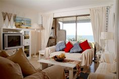 White furniture in the lounge adds to the casual beach type experience Cottage Furniture, White Furniture, Cushion Fabric, Beach Cottages, Cushions, Lounge, Curtains, Type, Casual