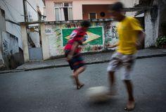 Brazilian children playing football in the streets of a favela in Rio de Janeiro