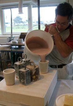 Thomas, the modelmaker, handles the heavy part of making a Splatterplatter for Louise Campbell at Royal Copenhagen