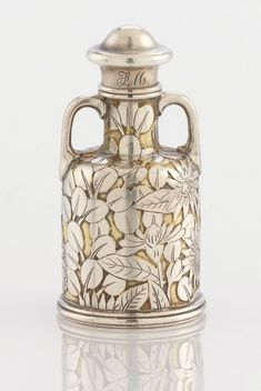 A Tiffany perfume bottle circa 1870-75. Silver and silver gilt, New York, . Marks: TIFFANY &CO.