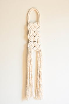 The birka knot has been designed to resemble flat knotted and woven metal decorations found on clothing once worn by Norsemen. Each cotton rope wall hanging has been knotted and stitched to keep it's shape. Each knot is made to order, please allow 10 days for your order to ship.