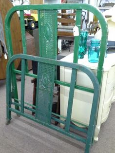 $75 - Antique metal twin headboard and footboard - Cameo Style - old metal wheels - Chippy green painted finish. No Rails - ***** In Booth G2 at Main Street Antique Mall 7260 E Main St (east of Power RD on MAIN STREET) Mesa Az 85207 **** Open 7 days a week 10:00AM-5:30PM **** Call for more information 480 924 1122 **** We Accept cash, debit, VISA, Mastercard, Discover or American Express