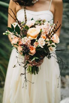 Wild wedding bouquet with juliet garden roses and feathers #weddingideas #weddingbouquets #weddingflowers