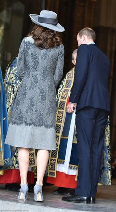 The Erdem coat featured very tiny checks and a lace overlay design three quarters of the way down.She matched her coat with a pair of round toe grey suede Winona pumps by Rupert Sanderson