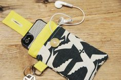 phone slip case with keyring & pocket for earbuds? Yes.