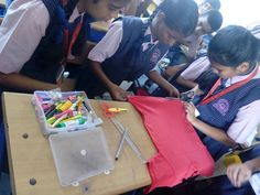 Darshana ,Ishita & Kavita  making apron with  best out of waste material . #best #art #students #school #good