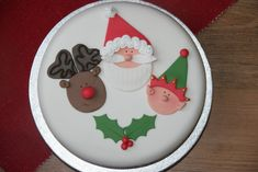 Santa, Rudolph and Cheeky Elf Cake.  This is one from www.thepinkwhisk.co.uk.  I always go to them first when I am looking for a recipe or a tip of how to do something cake related!