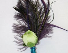 Purple Feather Boutonniere with green rananculus bud