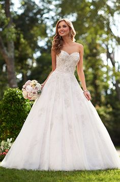 This gorgeous silver lace and tulle ball gown wedding dress featuring hand-beaded details. Stella York, Spring 2015