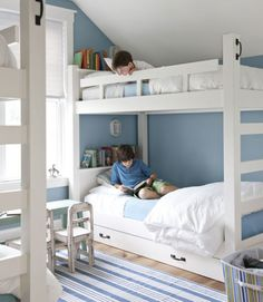 The compact boys' room in this Vermont country home features custom bunks that were designed with extra storage in mind. A dusty shade of blue on the walls helps the room feel sweet, not cramped.