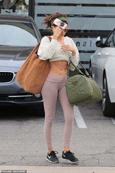 On Sunday she was spotted enjoying time with boyfriend Wells Adams at a farmers market in Studio City.And one day later, Sarah Hyland was spotted leaving the gy Pink Leggings, Colorful Leggings, Sarah Hyland, Workout Session, Alyson Hannigan, Old Actress, Blush Color, White Jeans, Cover Up