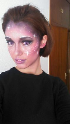 I did this galaxy make up for my Miss Universe costume... my bf is going as Buzz Lightyear ;) Love the purple contact lenses!!