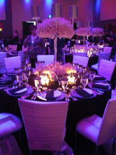 wedding reception with purple uplighting & hydrangea puff!