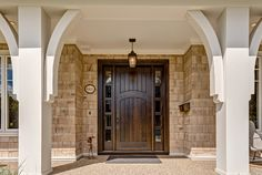 Pretty front door and support posts. Interior Design Ideas