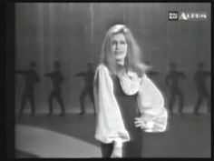 ..look it's ⊱✿APHRODITE✿⊰ in a wig doing Flamenco lolz...naa it's Dalida = Yolanda Cristina Gigliotti , best known as Dalida, was an Egyptian born French singer and actress of Italian descent who performed and recorded in more than 10 languages including: Arabic, Italian, Greek, German, French, English, Japanese, Hebrew, Dutch and Spanish.