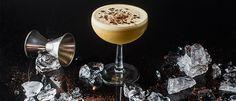 Eamon Rockey's Enlightened Mudslide. Homemade irsh cream liqueur. Homemade bourbon-coffee liqueur. Crushed ice, grated espresso beans.