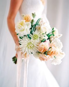 In this stunner byNatural Art Flowers, cactus dahlias nestle alonside white, peach, and pink roses, while pussy willow and milk berries provide a pretty accent.