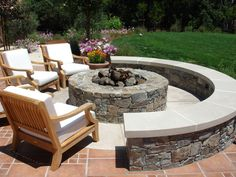 Combination stone seating with moveable furniture and stone fire pit. You can even sit on the outer ring. The movable chairs offer even more  flexibility.