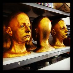 Sculptures by Arlene Rush at her studio - Chelsea Artists Open Studios, New York, NY #chelsea #artist #studio #openstudios #sculpture #shadows #head #face #gold #eyes - @arnab11- #webstagram