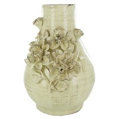Show off your fresh-picked flowers in this lovely ceramic vase with roses.