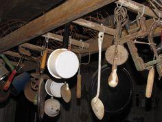 old utensils hanging in kitchen